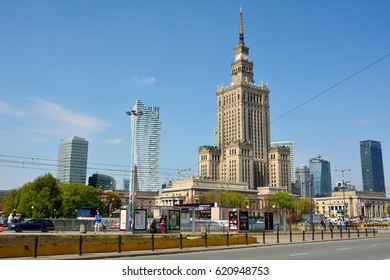 WARSAW, POLAND - MAY 3, 2016. Street view in Warsaw, with the Palace of Culture and Science, other commercial and residential buildings, people and city traffic.