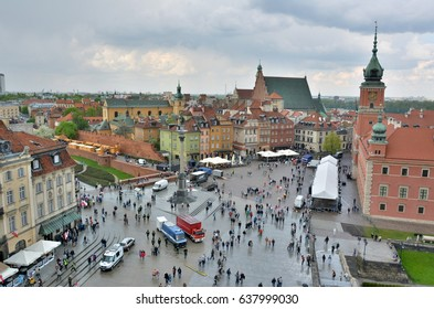 WARSAW, POLAND - MAY 3, 2016. Aerial view of Plac Zamkowy square in Warsaw, with historic building, including Sigismund III Vasa Column, and people.