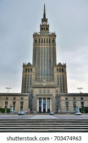 WARSAW, POLAND - MAY 3, 2016. Palace of Culture and Science in Warsaw, with cars, at dusk.