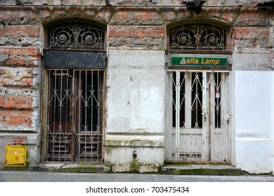 WARSAW, POLAND - MAY 3, 2016. Street view in Jewish ghetto quarter in Warsaw, with two locked doors and commercial properties.