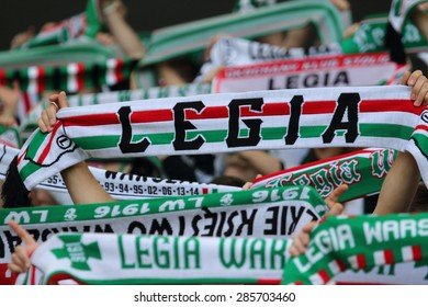 WARSAW, POLAND - MAY 31, 2015: Unidentified fans of Legia Warsaw during Polish League football match between Legia Warsaw and Wisla Krakow at the Pepsi Arena in Warsaw.
