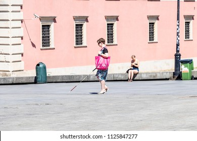 Warsaw, Poland May 31, 2018: Polish Blind woman walking near The Royal Castle of Warsaw in the city center. Poland