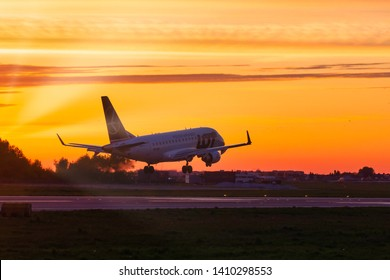 WARSAW, POLAND - MAY 9, 2019: LOT Polish Airlines airplane touching down at Chopin International Airport in Warsaw, Poland