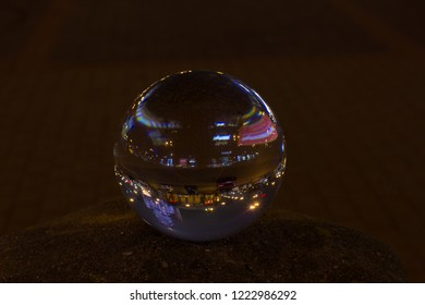 WARSAW, POLAND - NOVEMBER 03, 2018 Palace of Culture and Science Warsaw - reflection in crystal ball at night in rainy autumn time.