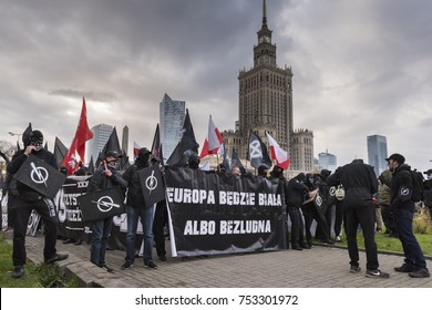 "WARSAW, POLAND - NOVEMBER 11, 2017: Gathering people for the annual march of Poland's National Independence Day. Nationalists with baner ""Europe will be white or deserted"""