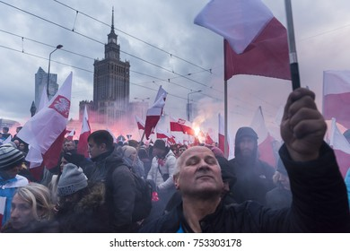 WARSAW, POLAND - NOVEMBER 11, 2017: The annual march of Poland's National Independence Day.  Thousands of nationalists burn flares and wave Polish flags under the slogan 'we want God'.