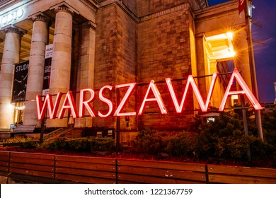 Warsaw, Poland - November 2, 2018:  Warsawa Neon Sing at night at the Palace of Culture and Science in Warsaw, Poland,