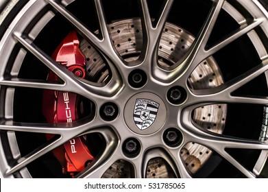 WARSAW, POLAND - NOVEMBER 21, 2016: Close up of a car's rim, wheel with Porsche emblem.