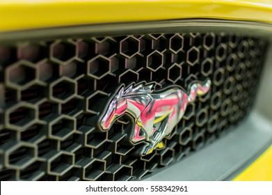 WARSAW, POLAND - NOVEMBER 21, 2016: Chrome Mustang logo on front of car close up.