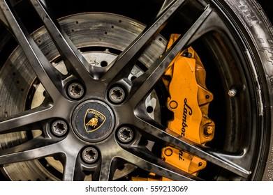 WARSAW, POLAND - NOVEMBER 21, 2016: Close up of a car's rim, wheel and breaks with Lamborghini emblem.