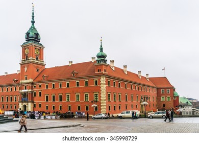 WARSAW, POLAND - NOVEMBER 28, 2015: Tourists on the Castle Square near Royal castle, Old town. Old town in Warsaw - UNESCO World Heritage Site.