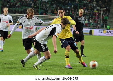 WARSAW, POLAND - November 28: Action in football match between Legia Warsaw and Lazio Rome, on November 28, 2013 in Warsaw, Poland.