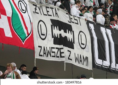 WARSAW, POLAND - November 28: Legia Warsaw Ultras flag in the grandstand of the Pepsi Arena stadium during football match between Legia Warsaw and Lazio Rome, on November 28, 2013 in Warsaw, Poland.