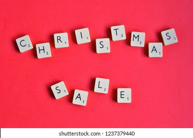 Warsaw, Poland - November 7 2018: Scrabble letters spelling MERRY CHRISTMAS . Scrabble tiles on the red background. Christmas message concept