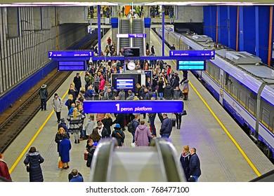WARSAW, POLAND - NOVEMBER 9, 2017 - Underground platform of Warszawa Centralna station with a Pesa Dart electric train