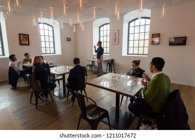 Warsaw, Poland - Oct 20, 2018: Visitors try different types of vodkas in the Warsaw Vodka Museum, Poland.