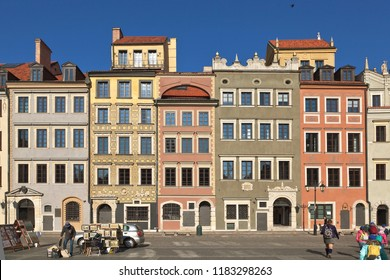Warsaw, Poland - October 01, 2017: Warsaw's Old Town Market Place, street artists, tourists, colorful facades of houses