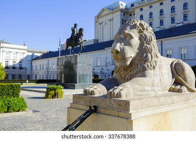 WARSAW, POLAND - OCTOBER 10, 2015: Lion and Prince Jozef Poniatowski statue seen in the distance, by Danish sculptor Bertel Thorvaldsen, in front of the courtyard of the Presidential Palace
