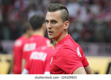 WARSAW, POLAND - OCTOBER 11, 2014: Arkadiusz Milik (Polish team and Ajax Amsterdam player) before the UEFA EURO 2016 qualifying match of Poland vs. Germany. Milik scored the opening goal in a 2�0 win.
