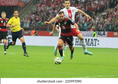 WARSAW, POLAND - OCTOBER 11, 2014: Mario Gotze in action (German team and Bundesliga club Bayern Munich player) during the UEFA EURO 2016 qualifying match of Poland vs. Germany
