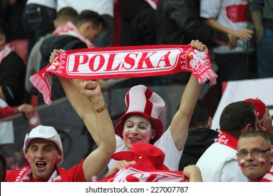WARSAW, POLAND - OCTOBER 11, 2014: Unidentified Polish fans in action during the UEFA EURO 2016 qualifying match of Poland vs. Germany