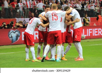 WARSAW, POLAND - OCTOBER 11, 2014: Polish players enjoy after scoring a goal during the UEFA EURO 2016 qualifying match of Poland vs. Germany. Final result: 2:0 for Poland