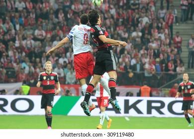 WARSAW, POLAND - OCTOBER 11, 2014: Robert Lewandowski (Polish team and Bundesliga club Bayern Munich striker) fights for the ball during the UEFA EURO 2016 qualifying match of Poland vs. Germany.
