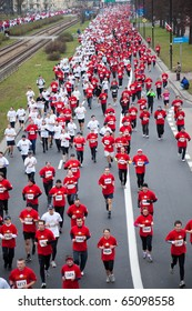 WARSAW, POLAND - OCTOBER 11: Runners participate in the 22nd Independence Run (10km) on October 11, 2010 in Warsaw, Poland. All 7000 participants wear white and red t-shirts - polish national colors.