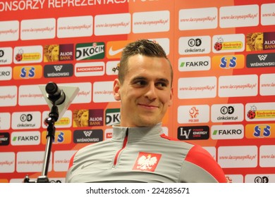 WARSAW, POLAND - OCTOBER 13, 2014: Arkadiusz Milik, Ajax Amsterdam and Polish national football team player attends a press conference before the UEFA EURO 2016 qualifying match of Poland vs. Scotland
