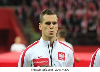 WARSAW, POLAND - OCTOBER 14, 2014: Arkadiusz Milik (Polish team and Ajax Amsterdam player) before the UEFA EURO 2016 qualifying match of Poland vs. Scotland