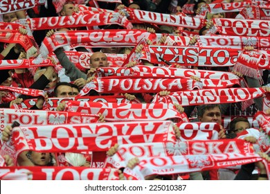 WARSAW, POLAND - OCTOBER 14, 2014: Polish fans in action during the UEFA EURO 2016 qualifying match of Poland vs. Scotland