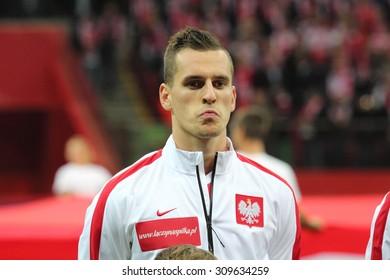 WARSAW, POLAND - OCTOBER 14, 2014: Arkadiusz Milik (Polish team and Ajax Amsterdam striker) before the UEFA EURO 2016 qualifying match of Poland vs. Scotland.