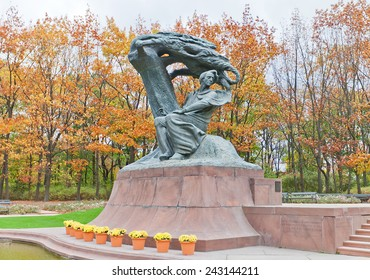 WARSAW, POLAND - OCTOBER 20, 2014:  Frederic Chopin Statue in Royal Baths Park of Warsaw, Poland. Sculptor Waclaw Szymanowski. Erected in 1926, destroyed by Nazi in 1940, reconstructed in 1958