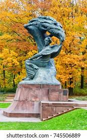 WARSAW, POLAND - OCTOBER 26, 2016: Fryderyk Chopin monument in autumn scenery of the Royal Lazienki Park in Warsaw, Poland, designed around 1904 by Waclaw Szymanowski (1859-1930).