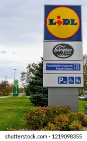 Warsaw, Poland - October 26 2018: Sign Lidl. Outdoor company signboard, logo. Opening hours and amenities icons. Lidl Stiftung & Co. KG is a German global discount supermarket chain with 10,000 stores