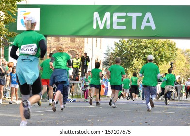 WARSAW, POLAND - OCTOBER 3: Runners compete in the Run Warsaw a 10km race on through the main streets of city, October 3, 2010 in Warsaw, Poland.
