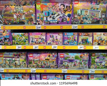 Warsaw, Poland - October 4 2018: Carefour supermarket stand full of packages with lego toys. Lego Firends series is telling the adventures of five girls: Andrea, Emma, Mia, Olivia and Stephania