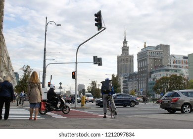 Warsaw, Poland - October 5 2018:  People and vehicles at a busy road intersection on Marszałkowska street in Warsaw
