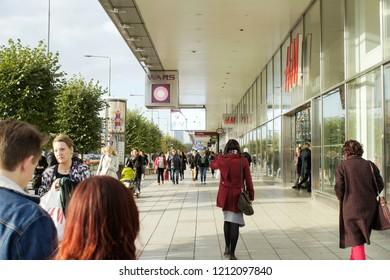 Warsaw, Poland - October 5 2018:  Shops and pedestrians on Marszałkowska street