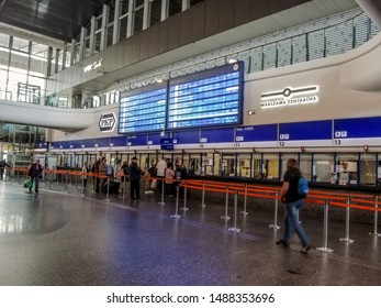Warsaw, Poland - October 9, 2018: People buy train tickets at the box office of Warszawa Centralna railway station. Main hall of the central train station