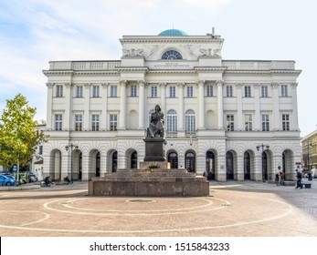 Warsaw, Poland - October 9, 2018: Nicolaus Copernicus Monument before the Staszic Palace on Krakowskie Przedmiescie in Warsaw. A square with a sculpture by Bertel Thorvaldsen and an old building