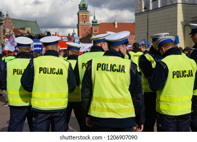 Warsaw / Poland - October.02.2018: Demonstration, national protest of police officers for fair work wages. Group of police officers with police sign on the back of the uniform green west.