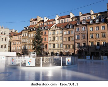 WARSAW, POLAND on DECEMBER 2018: Buildings at Old Town Market Place and icerink in european capital city with clear blue sky in cold sunny winter day.