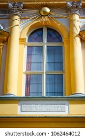 WARSAW, POLAND - SEPTEMBER 13, 2009: Wilanow Royal Palace front facade window with golden Sun rays. Latin inscription QUOD VETUS URBS COLUIT