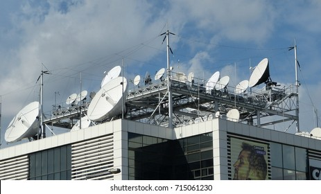 WARSAW, POLAND - SEPTEMBER 14, 2017: Satellite dishes on the roof of the headquarters of ITI Neovision Polish media company company in Warsaw owned by Canal+, operator of Polish satellite platform NC+