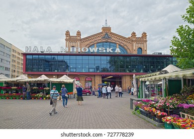 WARSAW, POLAND - SEPTEMBER 14, 2017: Frontal view of Hale Mirowskie (Hala Mirowska, in Polish) market building, constructed in 1901 in Warsaw. View at overcast day.