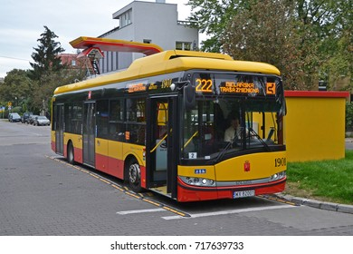Warsaw, Poland - September, 16, 2017: Electric bus Solaris Urbino 12 with modern pantograph raised during charging on the bus loop.