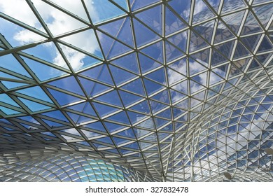 WARSAW, POLAND, SEPTEMBER 20: Blue roof in modern building made of glass and steel with the sky in the background, Warsaw, Poland.