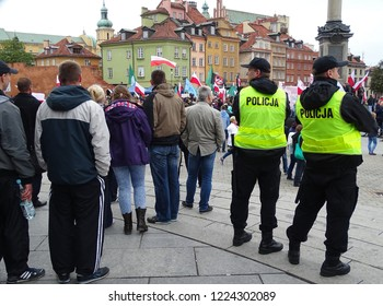warsaw / Poland - September 26 2015: Policemen, watchers and participants of anti-immigrants, anti-islamic meeting organized by Ntional Radical Camp, banners, Polish flags, Warsaw 26 September 2015