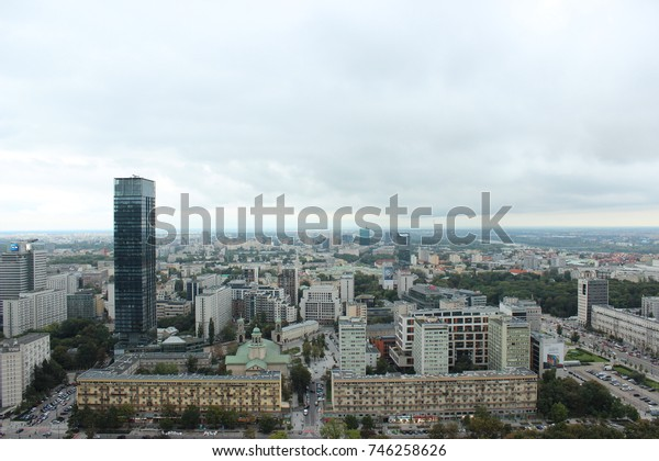 Warsaw, Poland - September 27, 2017: Urban Warsaw top view on modern skyscraper and old architecture in cloudy day
